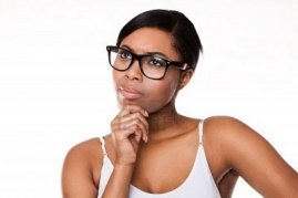 Black-woman-thinking-wearing-glasses-on-white